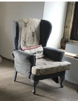 A classic wing back chair before it was re upholstered